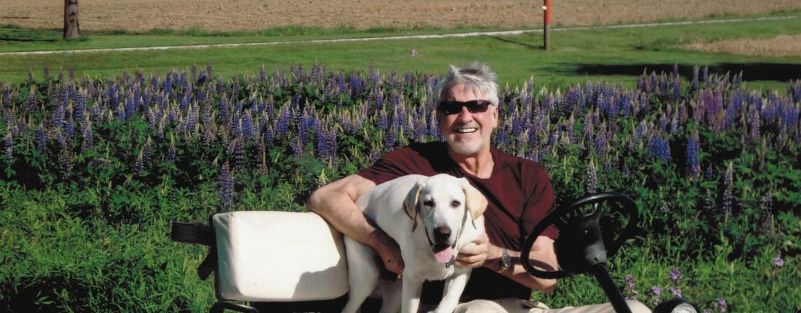 Joseph Holson & Tarpin Enjoying the Purple Lupines at the Farm